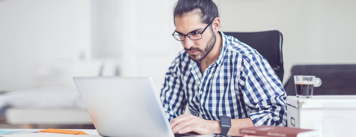 Male working on a laptop