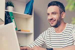 man behind laptop
